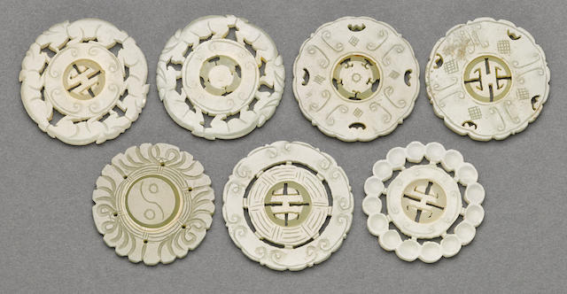 A group of seven jade and hardstone disks