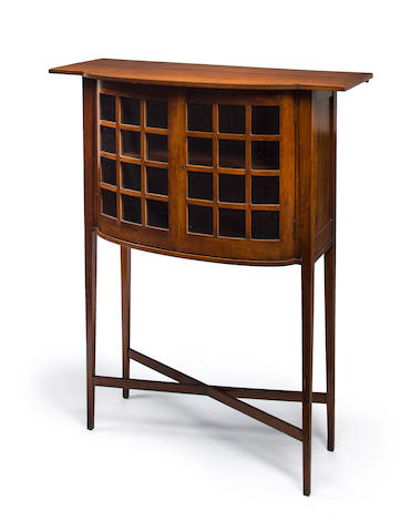 A George Walton glazed oak Holland cabinet produced by J.S. Henry, circa 1900