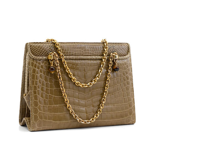 A Gucci tan crocodile handbag