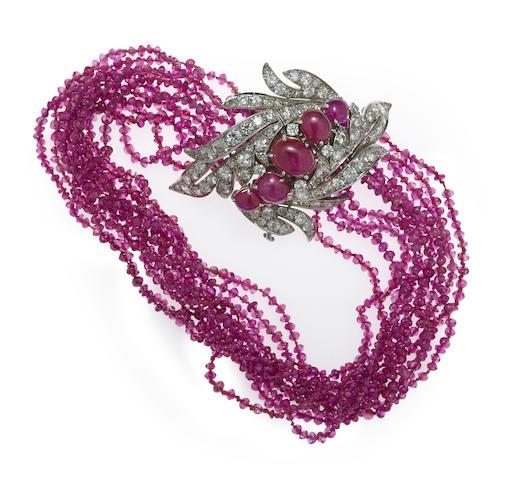 A pink sapphire, ruby and diamond multi-strand bracelet