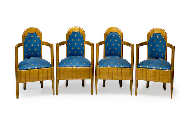 A set of four Pierre Patout carved sycamore armchairs from the 1st Class Dining Room of the S.S. Ile de France circa 1927