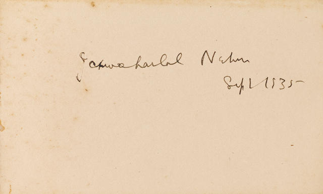 GANDHI, MOHANDAS K. 1869-1948. Autograph album signed and inscribed by Gandhi in Gujarati,