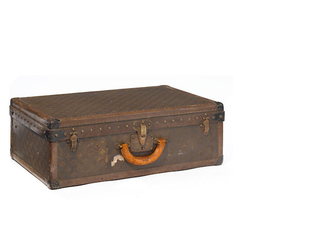 A Louis Vuitton monogram hard sided suitcase