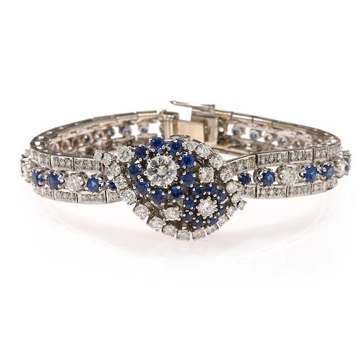 A sapphire, diamond and eighteen karat white gold covered dial integral bracelet wristwatch, Rolex
