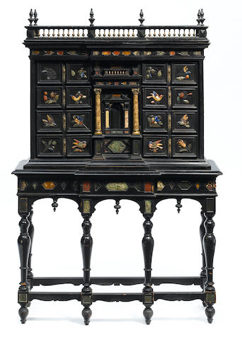 An Italian Baroque gilt metal mounted polished hardstone ebonized cabinet on stand incorporating antique and later elements