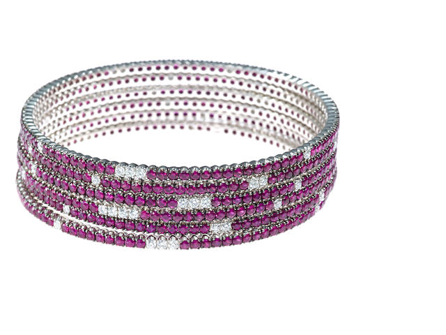 A set of six ruby and diamond bangle bracelets, Crivelli