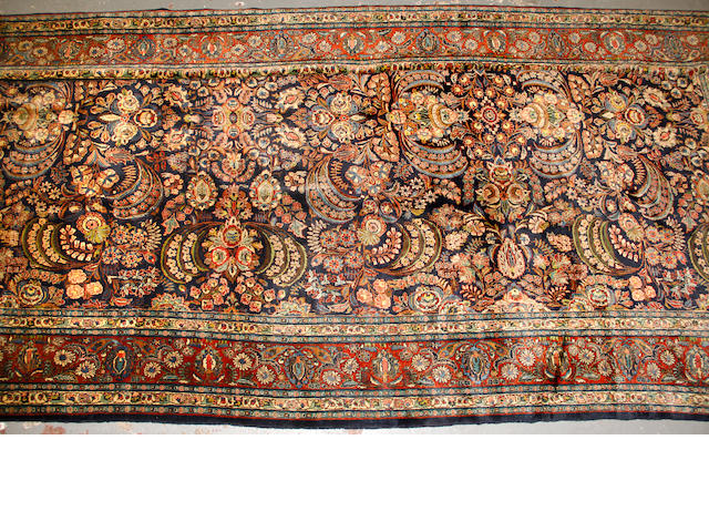 A Hamadan carpet size approximately 11ft. x 21ft. 3in.