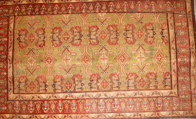 An Oushak carpet size approximately 12ft. 6in. x 15ft. 2in.