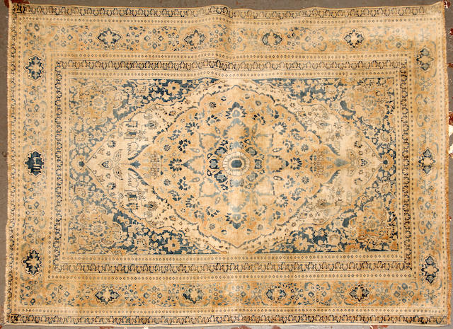 A Tabriz rug size approximately 4ft. 2in. x 5ft. 6in.