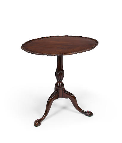 A George III carved mahogany oval tilt-top tea table late 18th century