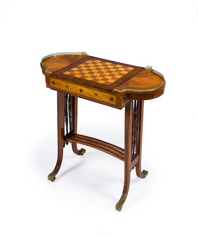 A Regency inlaid mahogany games table second quarter 19th century