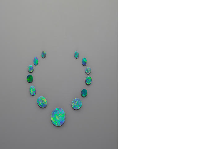 Magnificent Suite of Thirteen Black Opals