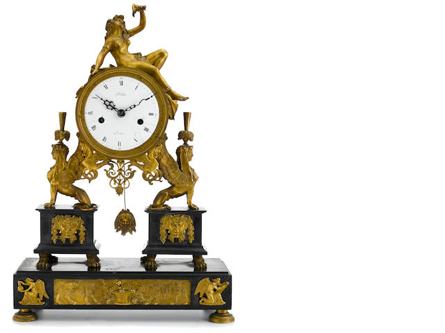 A Louis XVI gilt bronze and black slate mantel clock fourth quarter 18th century