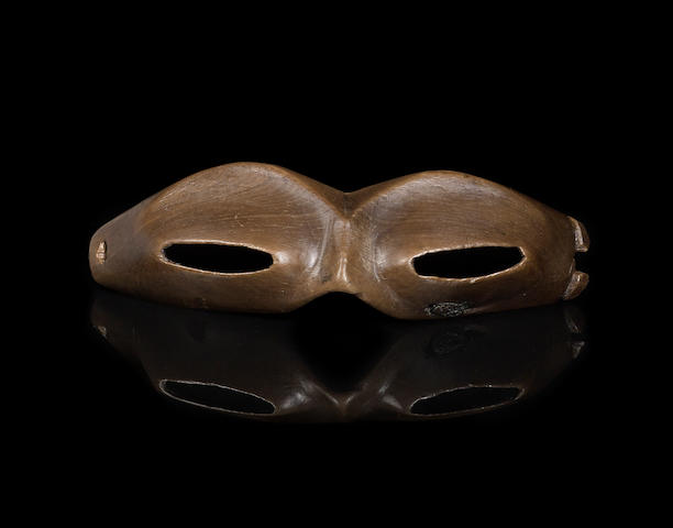 A pair of extremely rare and fine Okvik wood snow goggles