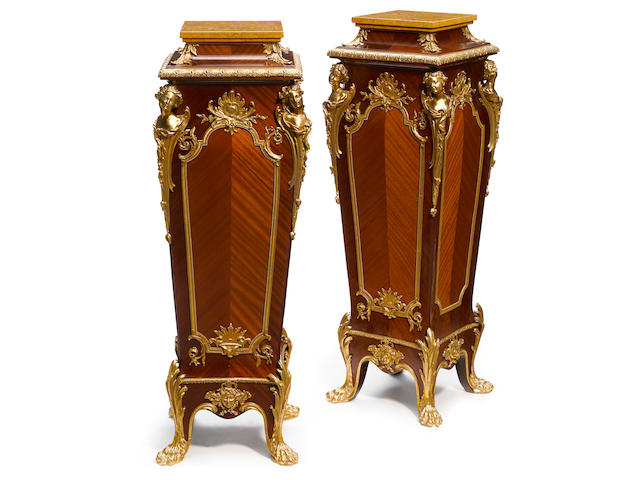 A pair of Louis XV style gilt bronze mounted mahogany pedestals