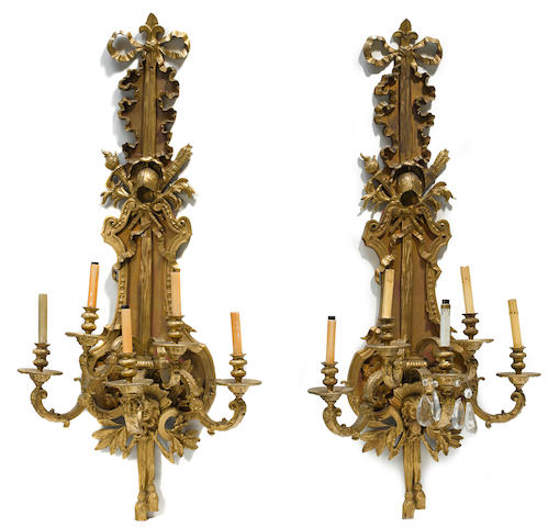 A pair of Louis XVI style gilt bronze and partial paint decorated five light bras de lumière first half 20th century