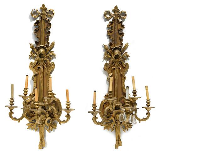 A pair of Louis XVI style gilt bronze and partial paint decorated five light bras de lumière first half 20th century