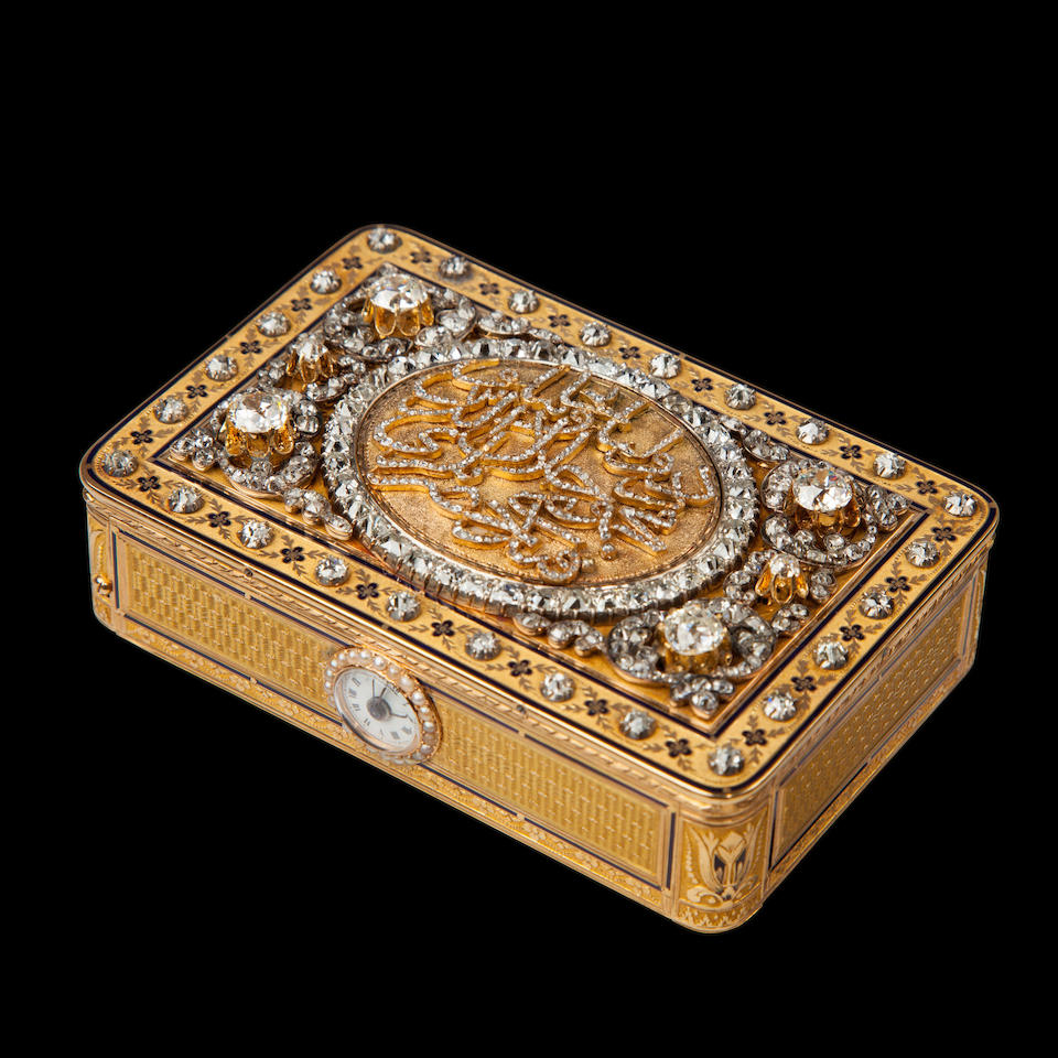 A fine and rare diamond-set engraved and enameled gold singing bird snuff box with musical movement and watch The box with the lozenge maker's mark of Jean-Georges Réymond, Geneva 1798 - 1815, and the mark of les frères Rochat, the movement stamped with serial number 7, circa 1804, and later embellished