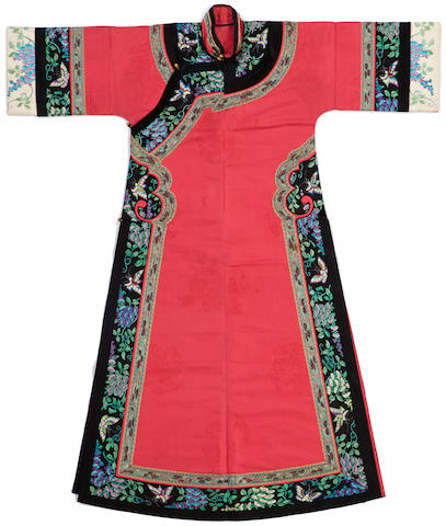 A Manchu woman's cerise brocade silk informal robe, changyi Late Qing dynasty