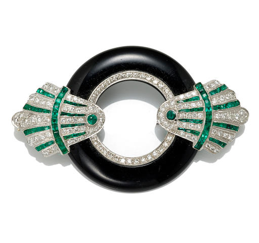 An emerald, black onyx and diamond brooch