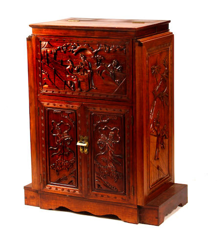 An Asian style hardwood drinks cabinet