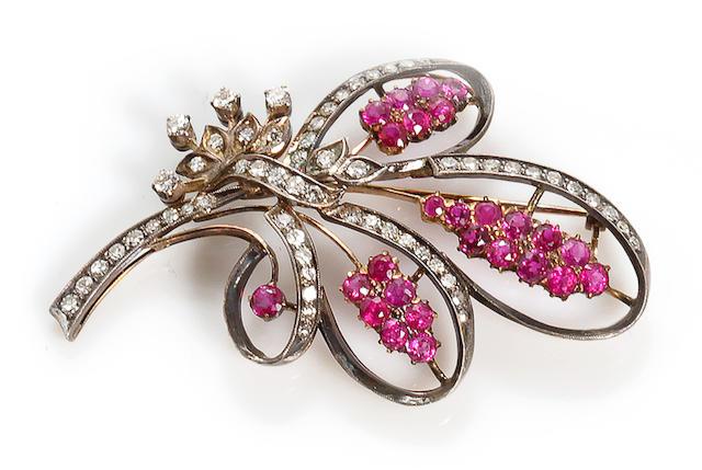 A ruby and diamond stylized bouquet motif brooch