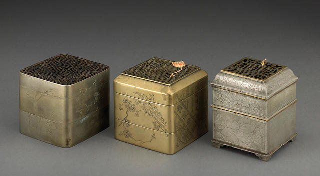 A group of three square-sectioned metal incense clocks 19th century