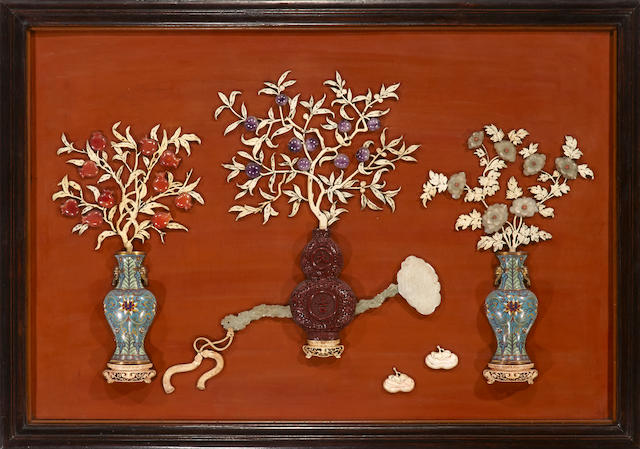 A lacquered wood wall panel with mixed hardstone, ivory, lacquer and cloisonné applied decoration Late Qing dynasty