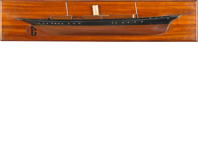 A builder's half model of the steam yacht Corsair (II) 12 x 43-3/4 in. (30.4 x 111.1 cm.) backboard.