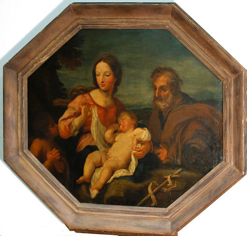 Follower of Guido Reni (Calvenzano 1575-1642 Bologna) The Holy Family octagonal, 28 x 34 1/4in