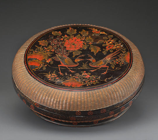A large lacquer circular box and cover with painted and woven decoration 17th/18th century