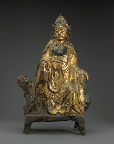 A large gilt lacquered bronze figure of Guanyin Ming dynasty