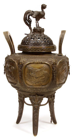 A Japanese patinated bronze tripod censer