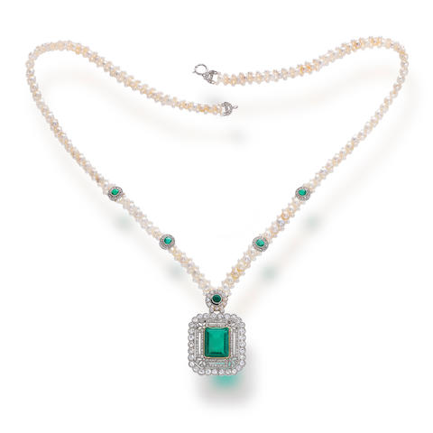 An antique emerald, and a diamond pendant, circa 1910, suspended from a later added cultured pearl necklace