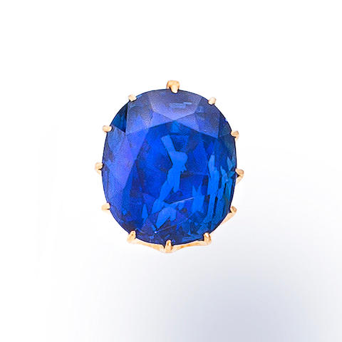 A sapphire and eighteen karat gold pendant fragment