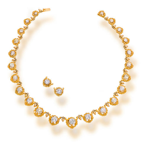 A diamond and eighteen karat gold necklace and diamond earrings