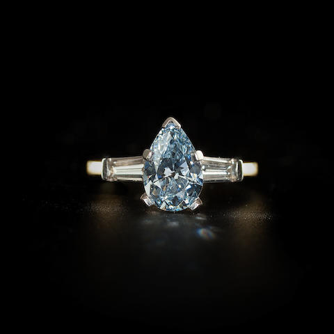 A fine fancy colored diamond and diamond ring