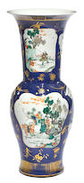 A massive powder blue ground  trumpet neck vase with famille verte enamel decoration Kangxi mark, 19th century