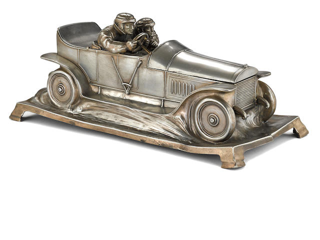 An early race car desk piece by Wurttembergische Metalwaren Fabrik,