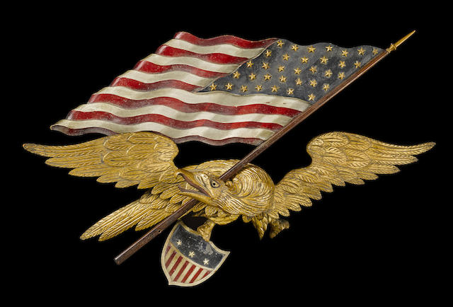 A carved and polychromed wing-spread eagle with flag and shield attributed to George Stapf (American, 1862-1958)  probably Harrisburg, Pennsylvania, 1890-1910