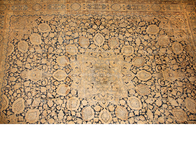 A Tabriz carpet size approximately 12ft. 5in. x 17ft.