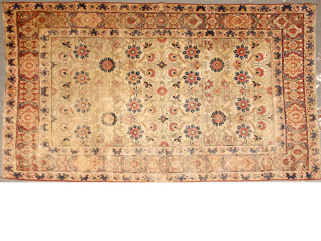 A Kerman rug  size approximately 5ft. 2in. x 7ft. 6in. size approximately 5ft. 2in. x 7ft. 6in.
