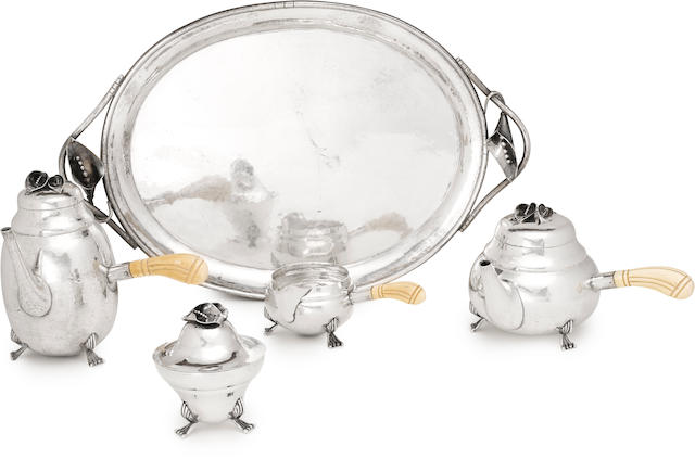 A sterling silver Art Nouveau style four-piece tea and coffee service with matching two-handled oval tray  probably Mexican, mid-20th century