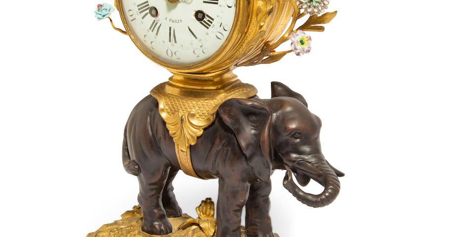 A fine and rare Louis XV porcelain, ormolu and patinated bronze elephant clock the case attributed to Philippe Caffieri, the calendar movement signed Viger à Paris, No. 166mid 18th century