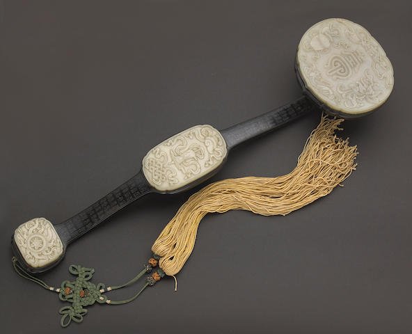 A jade and hardwood scepter with silver wire inlay