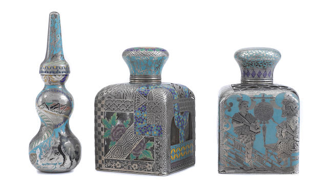 Three French first standard silver, cloisonné enamel and glass Aesthetic Movement scent bottles possibly designed by Paul Legrand, maker's marks illegible, retailed by Frédéric Boucheron, Paris,  circa 1878