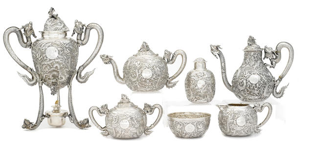 A Chinese Export  silver  seven-piece tea and coffee service undersides of teapot, coffee pot, tea caddy and burner with character marks and marked for Woshing, Shanghai,  fourth quarter 19th century