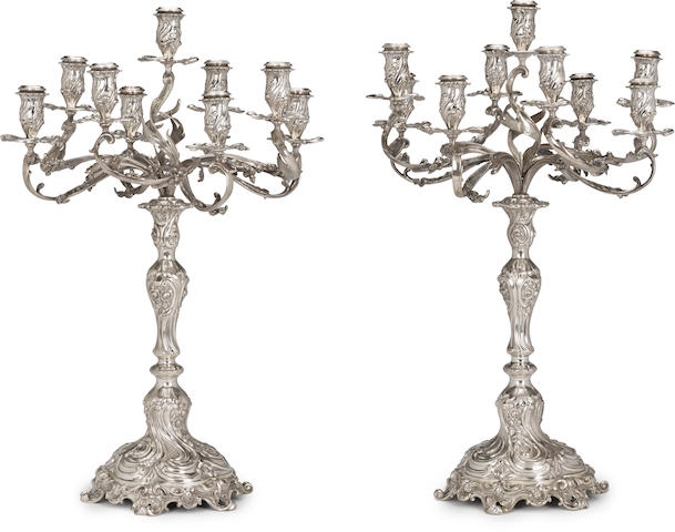 A pair of Continental 800 standard silver Rococo style nine-light candelabra maker's mark HG, second quarter 20th century