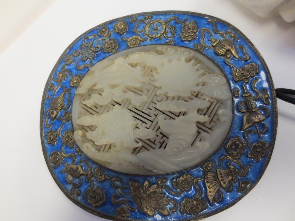 A reticulated jade plaque now mounted on a hand mirror The jade 19th century