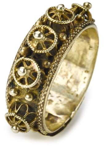 A Continental gold marriage ring 17th century  with band applied with bosses and graining; surmounted by a plaque with a Hebrew inscription.